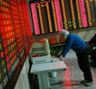 Chinese investor watches stockmarket
