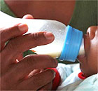 A baby being bottle-fed