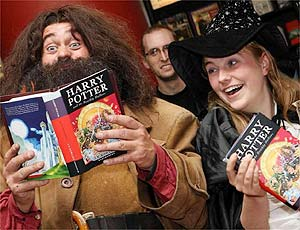 Fans with the new Harry Potter book, which has just gone on sale in London