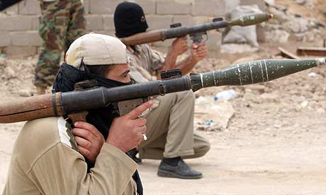 Mahdi army militiamen aim RPGs in Basra