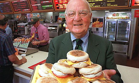 Herb Peterson, the creator of the Egg McMuffin, shows off his invention in this April 1997 file photo, at one of his McDonald's franchises in Santa Barbara, California.