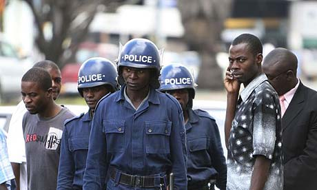 Zimbabwean police outside the High Court in Harare, Zimbabwe