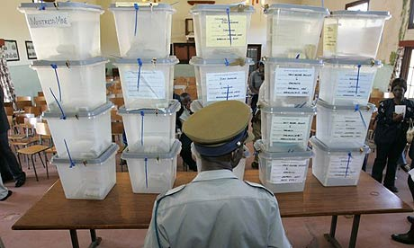 A policeman keeps watch over ballot boxes in the rural district of Domboshawa outside  Harare, Zimbabwe