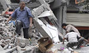 Dujiangyan residents search the debris of a collapsed house after an earthquake in Sichuan province, China