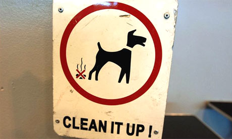A sign encouraging owners to clean up dog mess
