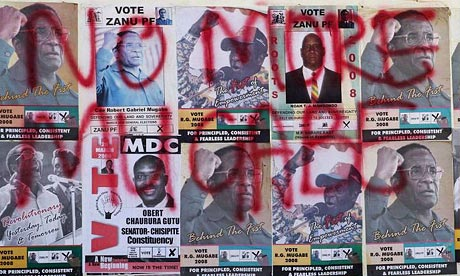 Zimbabwe election posters of Robert Mugabe covered in opposition slogans