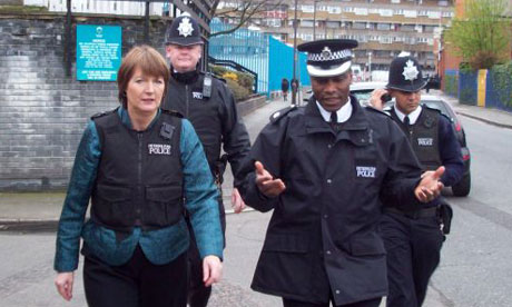 Harriet Harman wearing a 'stab vest' in Peckham, south London. Photograph: South London Press