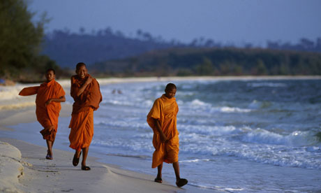 Cambodian monks on a beach