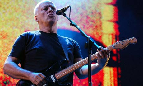 Dave Gilmour of Pink Floyd performing on stage
