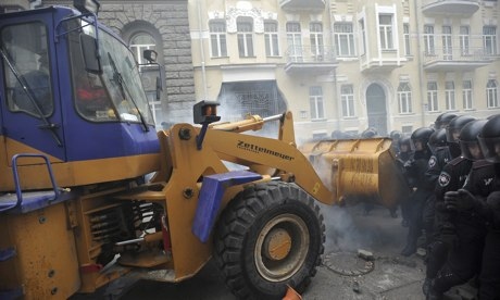 'masked protesters commandeered a mechanical digger and attempted to break through lines of armour-clad riot police' (c) Alexey Furman, EPA, the Guardian, 2nd December 2013