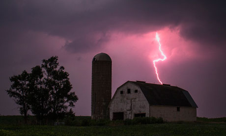 Lighting strikes over a barn in Iowa