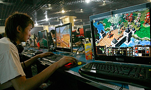 A Chinese youth plays an online game at a Internet cafe in Beijing